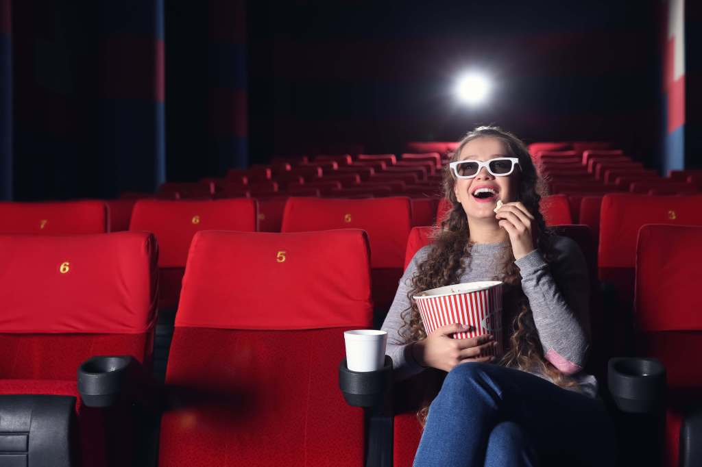 target audience demonstration with a girl in a cinema eating popcorn